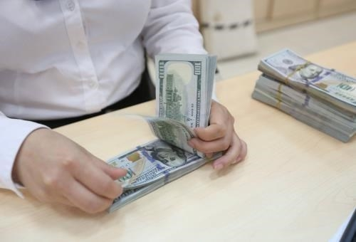 Exchange Rate Continues Downward Trend